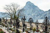 stock photo of graveyard  - Mountain Traunstein with Graveyard in the Foregrounde - JPG