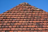 stock photo of gable-roof  - Part of the roof with old red tiles Armenia - JPG