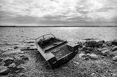 picture of old boat  - Old fishing motor boat on lake coast in Karelia - JPG
