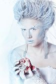 picture of snow queen  - Mysterious and unusual girl with face art in the form of the Snow Queen - JPG