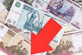 pic of depreciation  - Red arrow on Russian money as depreciation of currency - JPG