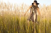picture of wander  - Beautiful lady model wandering through meadow wilds at midday - JPG