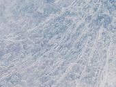 foto of ice crystal  - abstraction beautiful fragile rough crystal translucent blue ice surface with bubbles of air - JPG