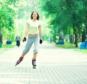 picture of inline skating  - Roller skating sporty girl in park rollerblading on inline skates - JPG