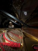 pic of grand piano  - Female pianist performing on a grand concert piano - JPG