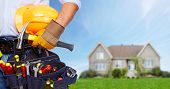 picture of carpenter  - Builder handyman with construction tools - JPG