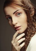 pic of braids  - close up portrait of beautiful young blonde woman with creative braids hairdo  - JPG