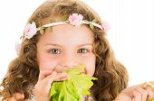 picture of healthy eating girl  - Beautiful healthy little curly girl enjoying eating a lettuce isolated on white - JPG