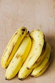 image of bunch bananas  - a bunch of bananas on wooden background - JPG