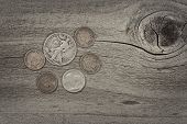 foto of copper coins  - Old United States coins on rustic wood with vintage concept - JPG