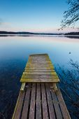 picture of pier a lake  - Small pier on lake long exposure photo - JPG