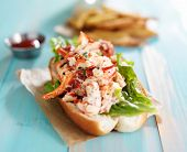foto of lobster  - lobster roll on colorful retro painted wooden planks - JPG