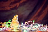 stock photo of gnome  - Christmas Lights With  Little New Year Gnome on warm Background