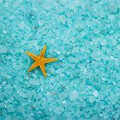 stock photo of starfish  - blue aromatic bath salt and starfish background - JPG