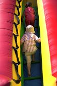 Young Boys Climbing Inflatable Bouncy