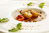 foto of basil leaves  - Soup with scallops and tomato decorated with basil leaves - JPG