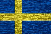 foto of sweden flag  - flag of Sweden or Swedish banner on canvas texture - JPG