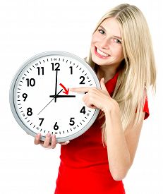stock photo of time-saving  - Young woman with a clock - JPG