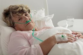 stock photo of respiratory  - Aged woman with serious disorder of respiratory system - JPG