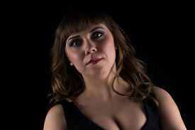 picture of curvy  - Portrait of brunette curvy woman on black background - JPG