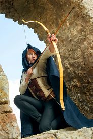 picture of bow arrow  - Ancient female archer with bow and arrow - JPG