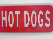 Metal White on Red Hot Dogs Sign