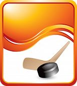 hockey stick and puck orange wave background