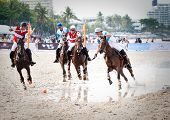 HUA HIN - APRIL 9: Thai Polo Team and Royal Pahang Polo Club Team during  the Asian Beach Polo Championship B Grimm  Princess Pa's Cup on Hua Hin beach. April 9, 2011 in Hua Hin, Thailand.