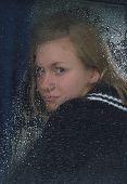 Girl Looks Thru Waterdropped Widow Glass 004