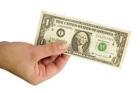 image of one hundred dollar bill  - Female hand with one dollar on a white background - JPG
