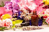 Flowers And Bottles Of Essential Oils For Aromatherapy poster