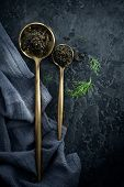 Black Caviar in a spoon on dark background. High quality real natural sturgeon black caviar close-up poster