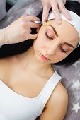 Woman Gets Injection In Her Face. Beauty Woman Giving Injections. Young Woman Gets Beauty Facial Inj poster