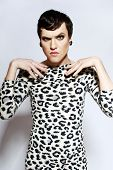 Transvestite With Tattoo In Leopard Dress, Hairstyle And Visage Looking In The Camera