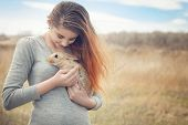 The Girl With The Rabbit.happy Little Girl Holding Cute Fluffy Bunny.friendship With Easter Bunny. S poster
