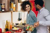 African-american Couple In Love Cooking Vegetarian Lunch Together In Kitchen, Copy Space poster
