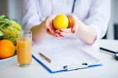 Diet. Doctor Nutritionist Hold Lemon In Her Office. Concept Of Natural Food And Healthy Lifestyle. F poster