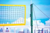 Beach Volleyball. Game Ball Under Sunlight And Blue Sky. Volleyball Net On The Tropical Beach poster