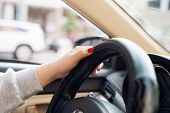 Asian Female Hands On The Steering Wheel Of A Car While Driving With Windshield And Road. Black Woma poster