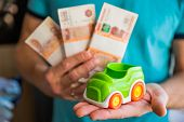 Business, Finance, Savings, Banking Or Car Loan Concept.miniature Car Model In Hand, Money And Savin poster