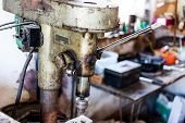 Metal Industry Stand With Drill Machine. Home Workshop With Hard Tools On The Metal Stand. Old Rusty poster