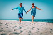 Happy Loving Couple Enjoy Tropical Beach Vacation poster