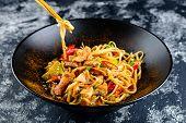 Udon Noodles With Chopsticks Of Japanese Food, Kudzued Udon, Udon Noodle Hot Pot. Wok. poster