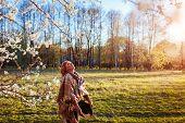 Happy Woman Relaxing In Spring Garden. Senior Woman Walking In Field. Lady Enjoying Life poster