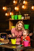 Earth Day Concept. Mother And Little Son Potting Flower On Earth Day. Mother And Child Replant Flowe poster