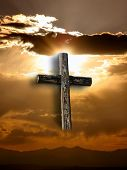 picture of christian cross  - a rugged cross against clouds - JPG