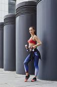 Fitness Sporty Woman With Jump Rope During Outdoor Exercises Workout. Beautiful Fit Girl. Fitness Mo poster