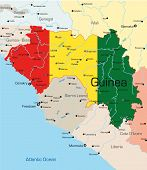stock photo of freetown  - Abstract vector color map of Guinea country colored by national flag - JPG