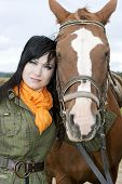 Portrait of beautiful brunette with horse