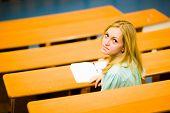 Student girl in auditorium